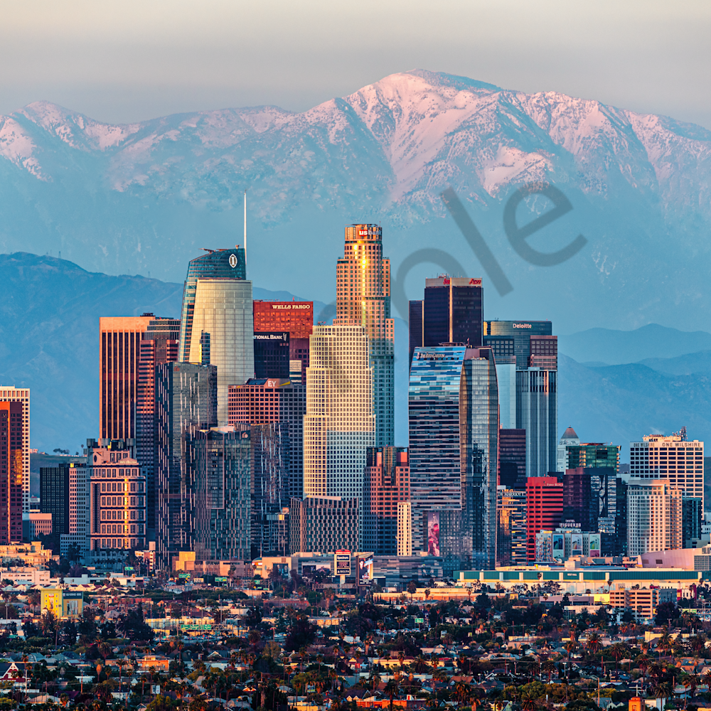 Los angeles skyline with san gabriel mountains with snow qmjmao