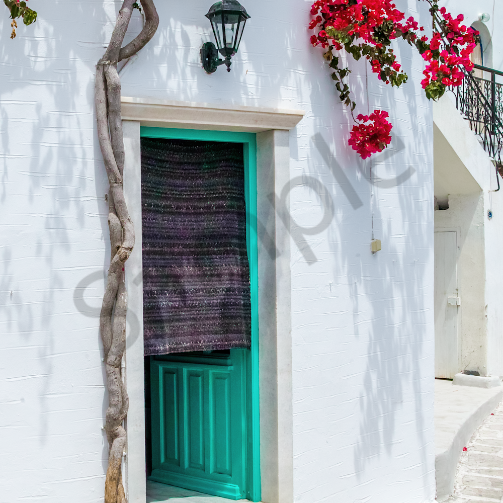 White wall with bougainvilleas paros greece jpytnk
