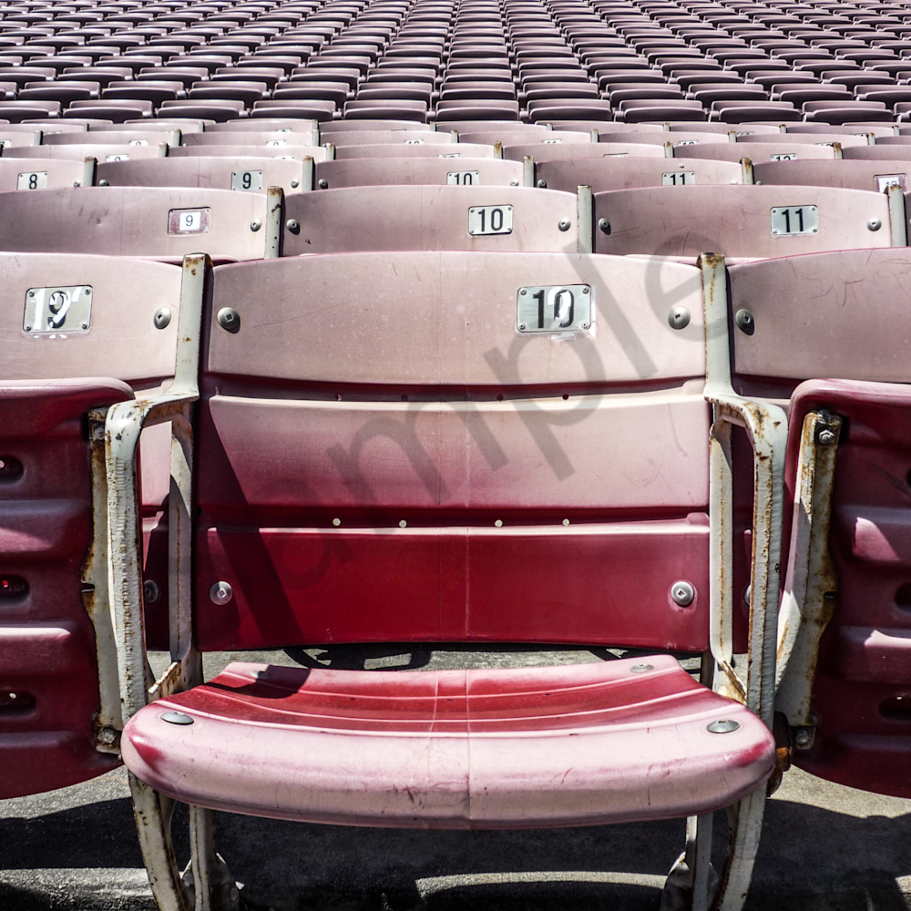 10 11 12 13 14 numbers stadium seat red close up number badge beat up rivets black number arena sports football pro college ncaa jfl baseball soccer seat down numeral aisle row angle front view horizontal view section c68l6g