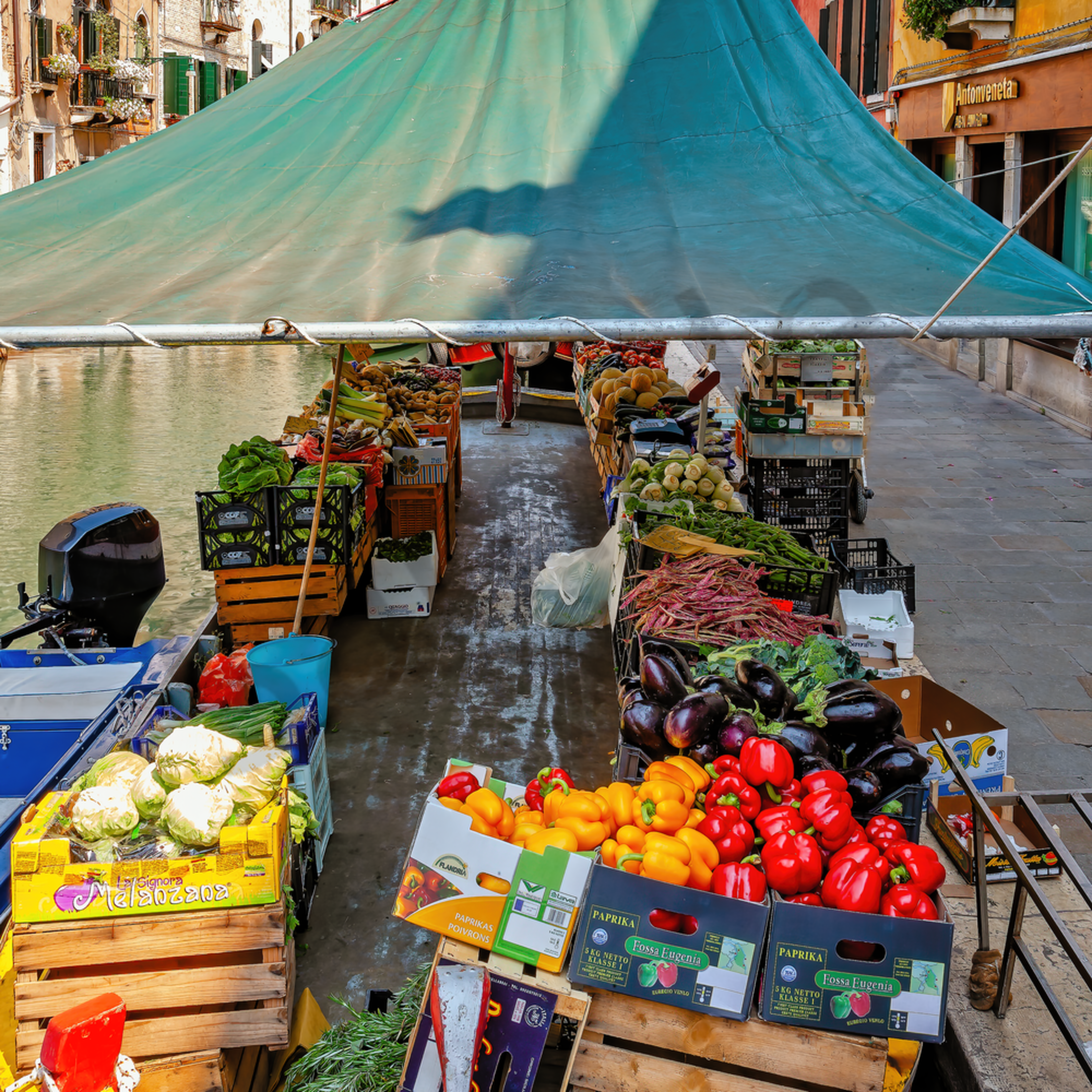 Fruits and vegetables on boat on canal in venice italy zyh0gx