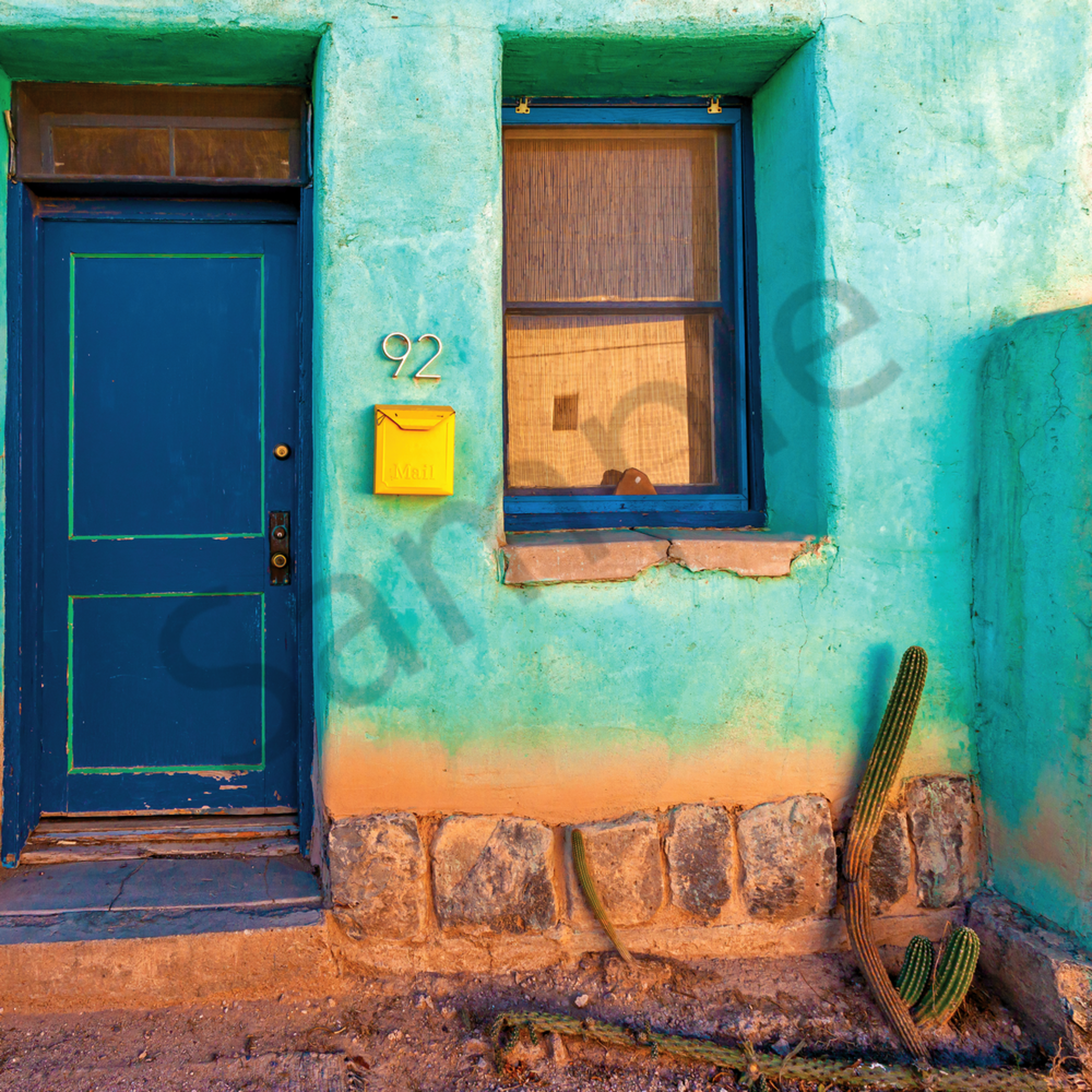 Green wall blue door yellow and mail box tucson arizona pwmbkn