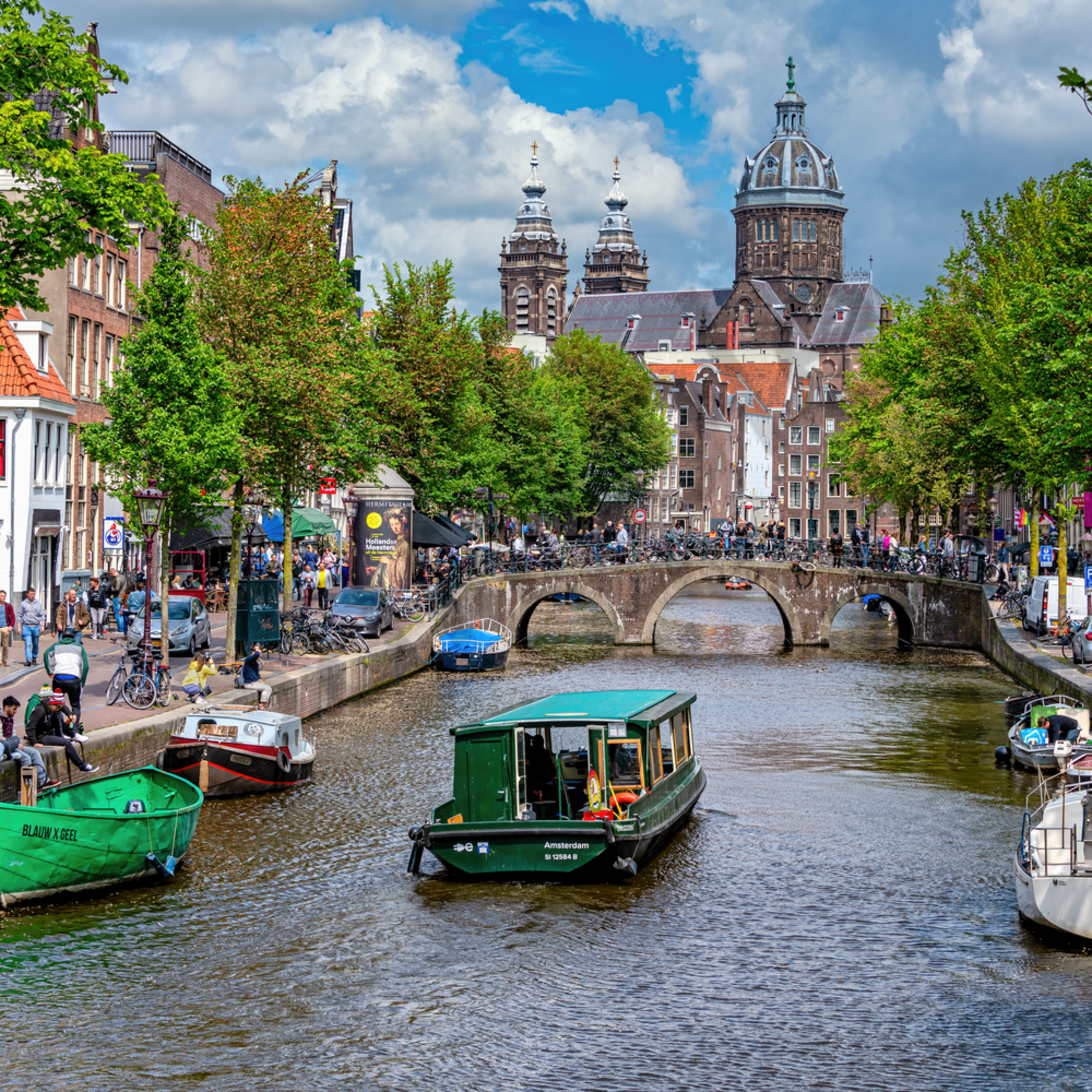 Amsterdam netherlands and canal with cathedral b1mzbe