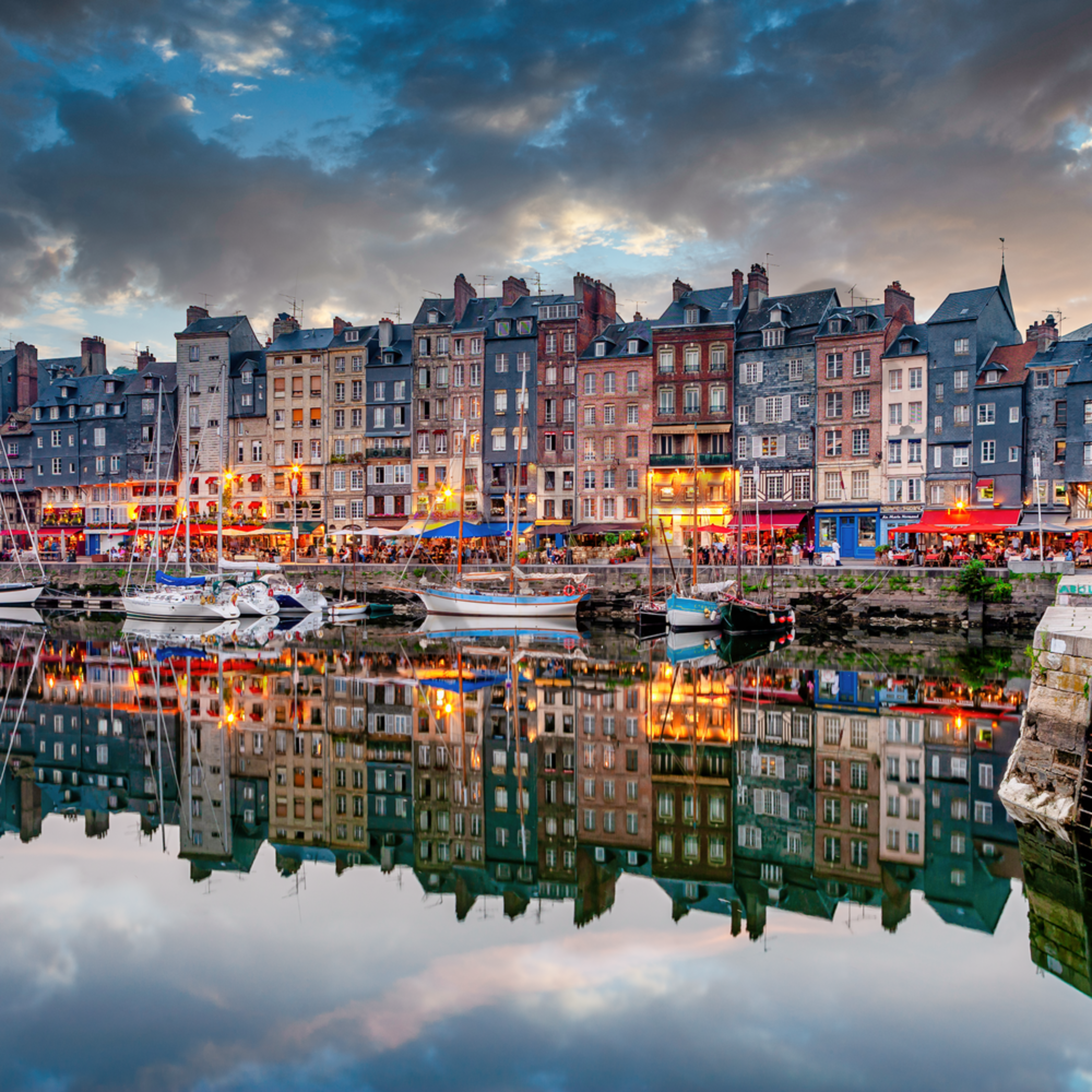 Honfleur and resturants by docks and sunset normandy france wnyyrn
