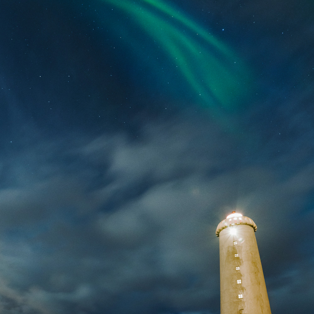Northern lights over lighthouse faded qisorp