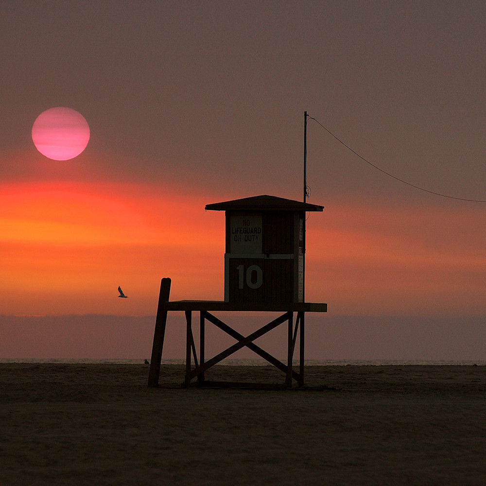 Lone vintage lifeguard stand wildfire sunset california dcn2dc