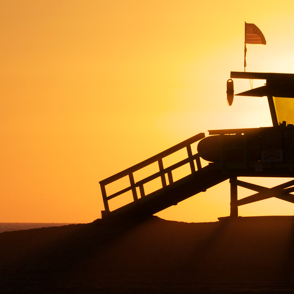 Lifeguard with couple silhouetted bzmzuc