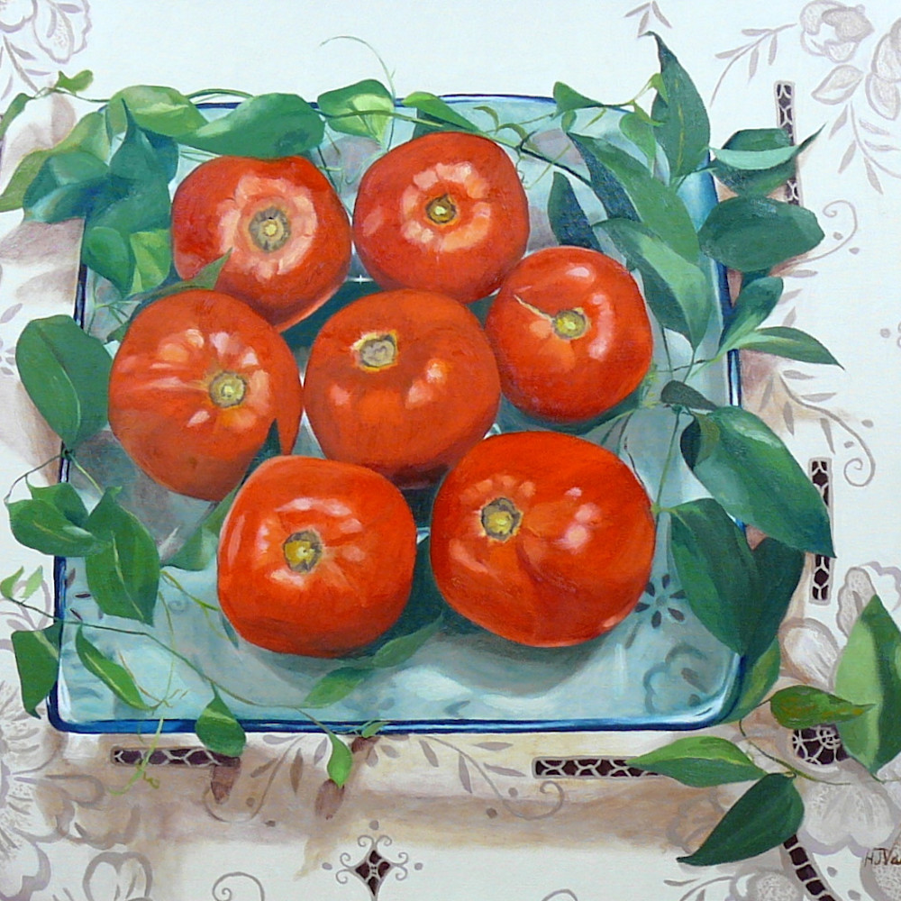 Tomatoes on a blue green plate ibloqe