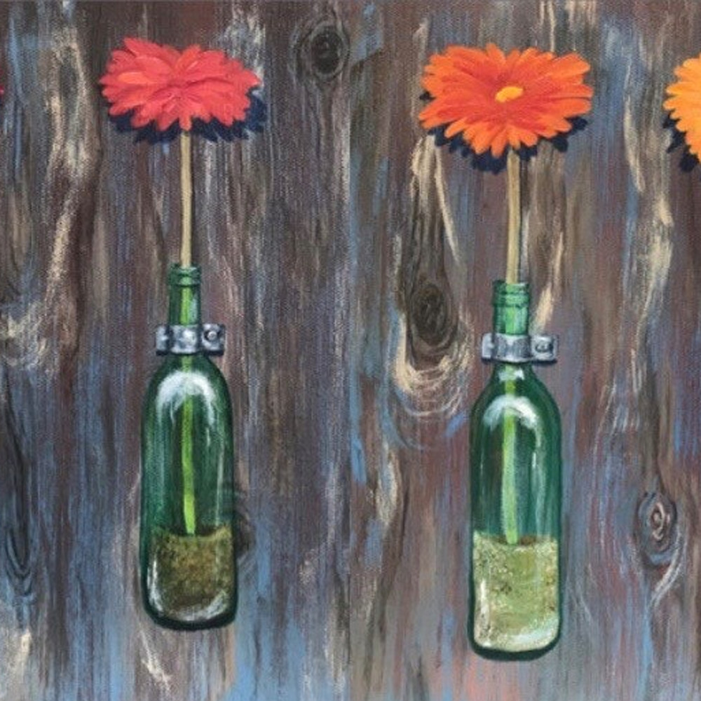 Fresh flowers in green glass bottles q8w4io