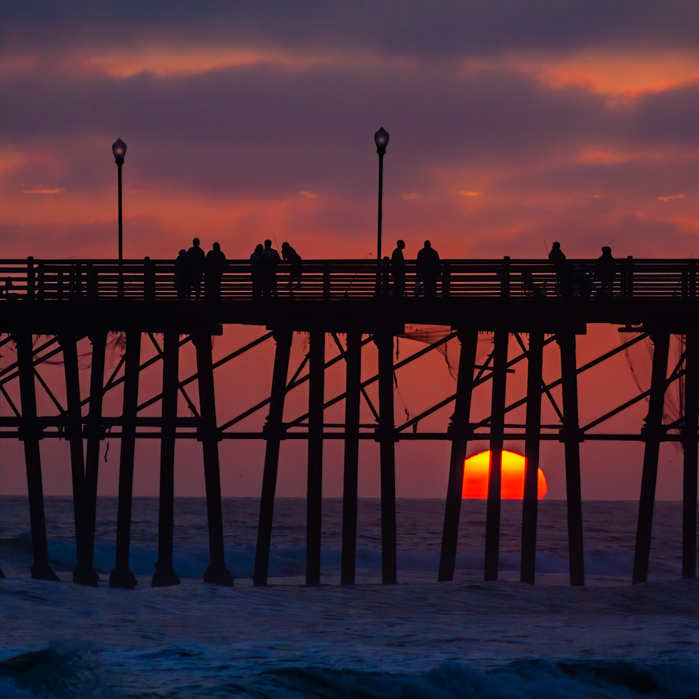 Dramatic sunset silhouettes pier aapqui