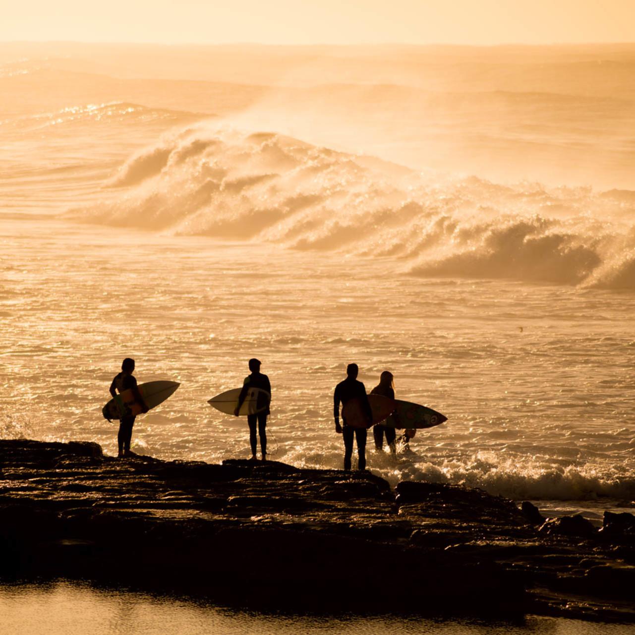 Surfers pause merewether beach newcastle nsw australia ljfklf