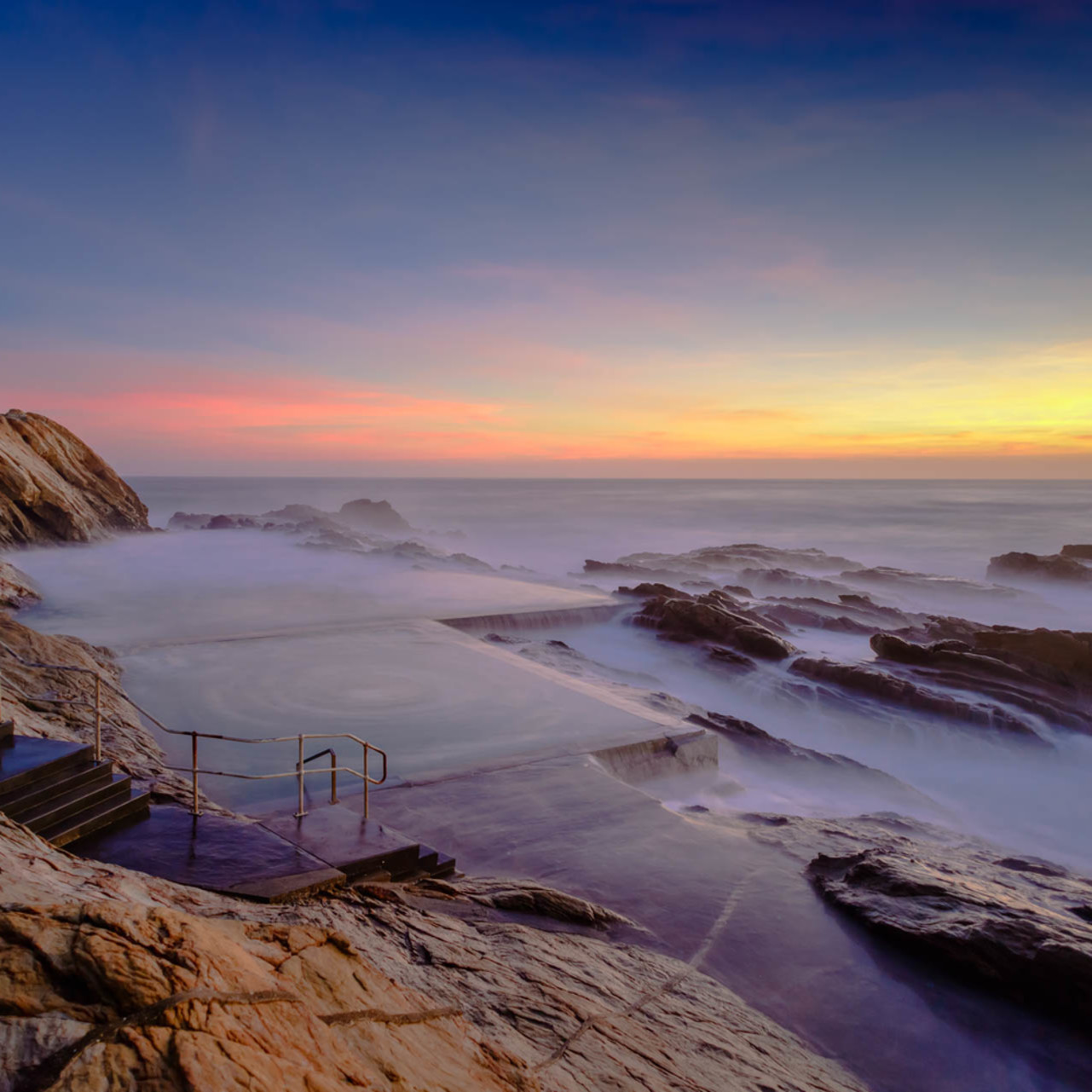 Blue pool sunrise bermagui nsw australia nql2e8