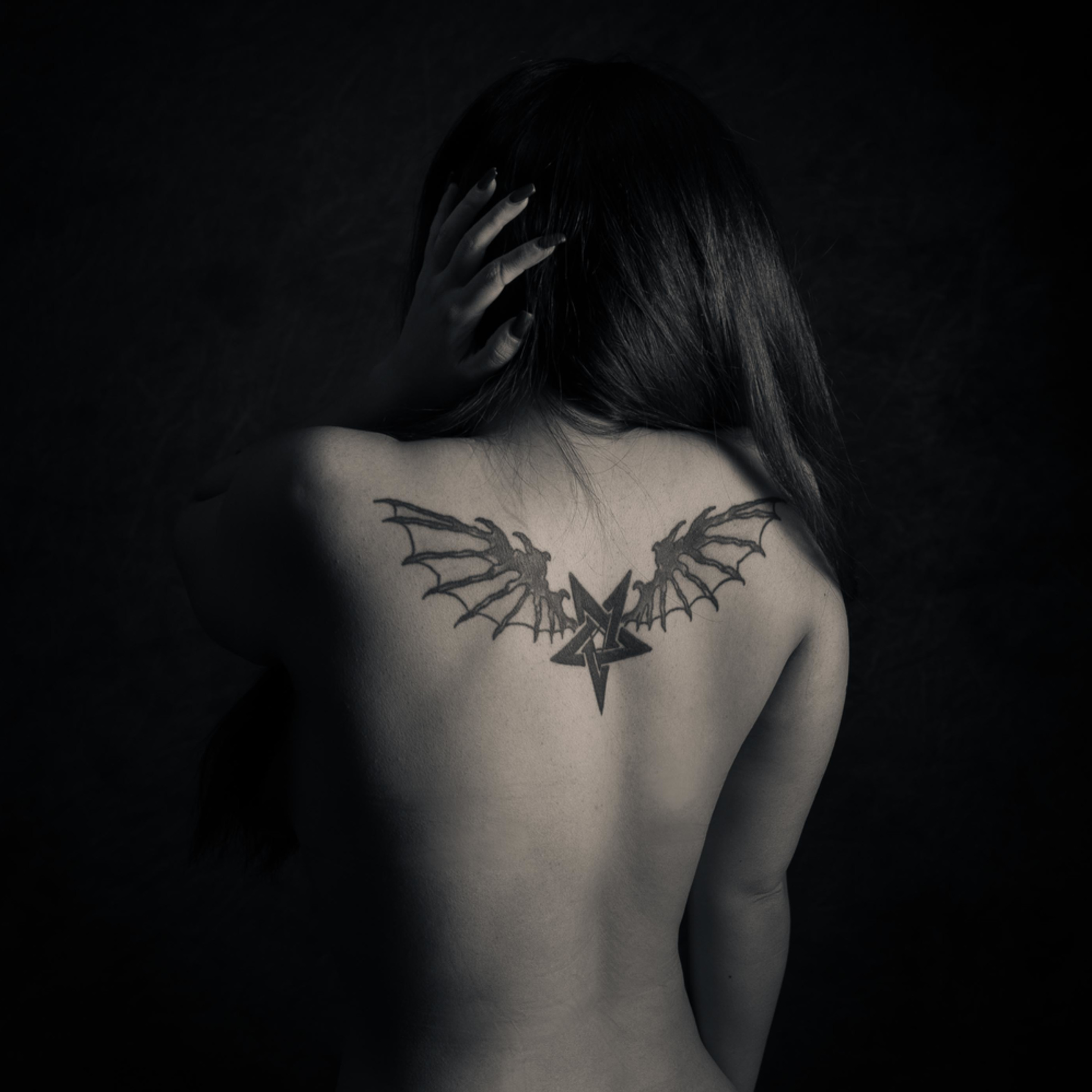Winged tattoo xeacez
