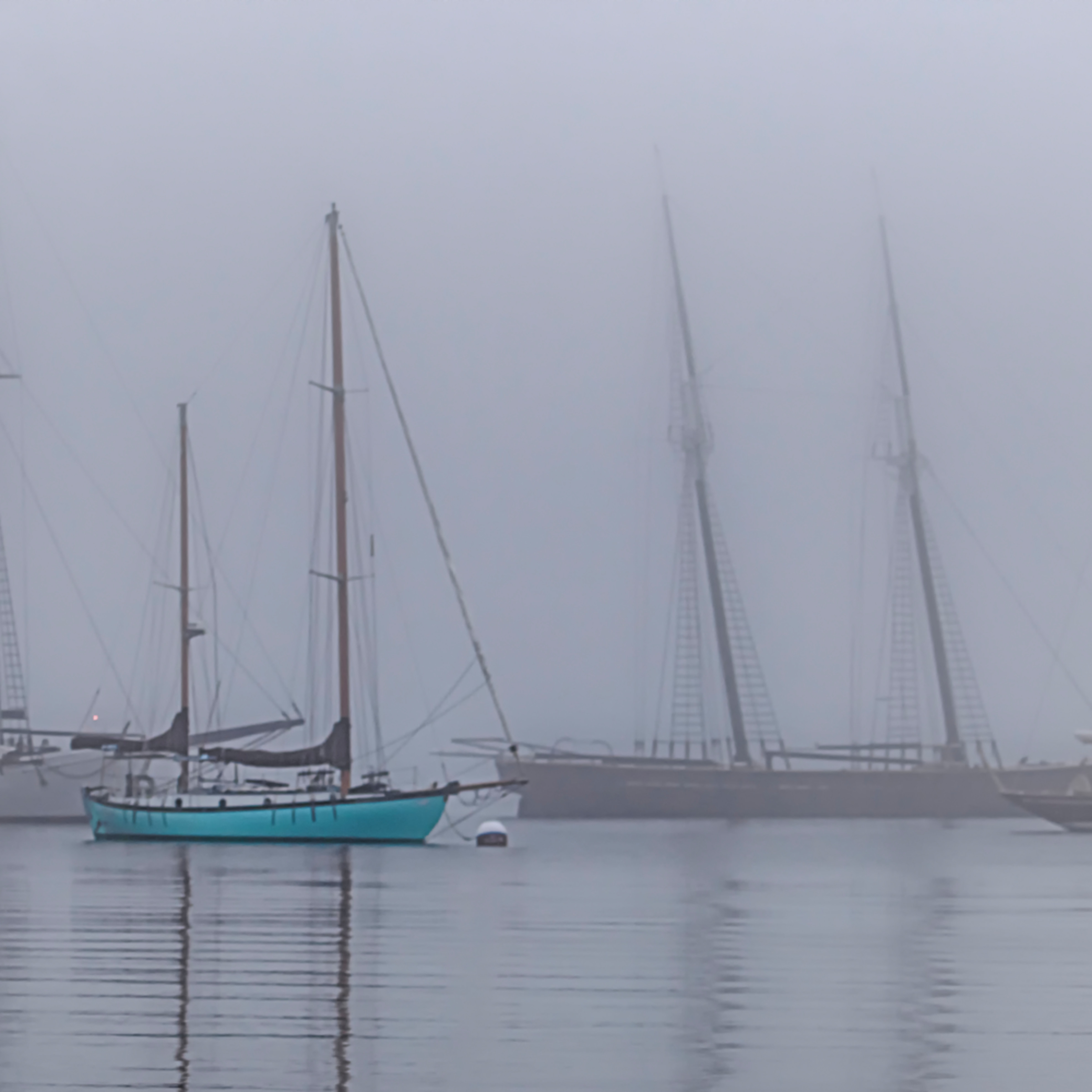 Vineyard haven harbor turquoise sail boat j6ccon