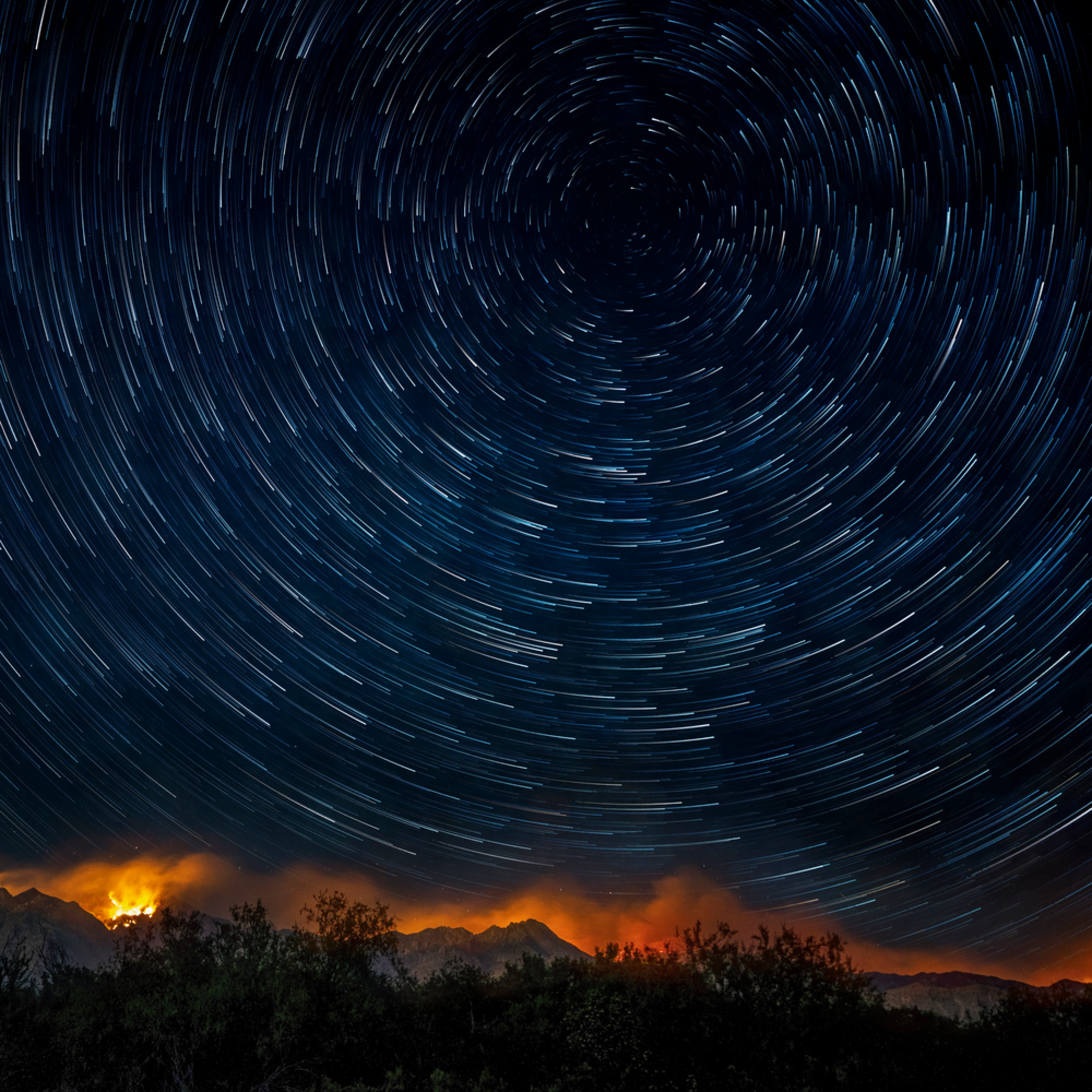 Star trails over bighorn fire nbm2qg