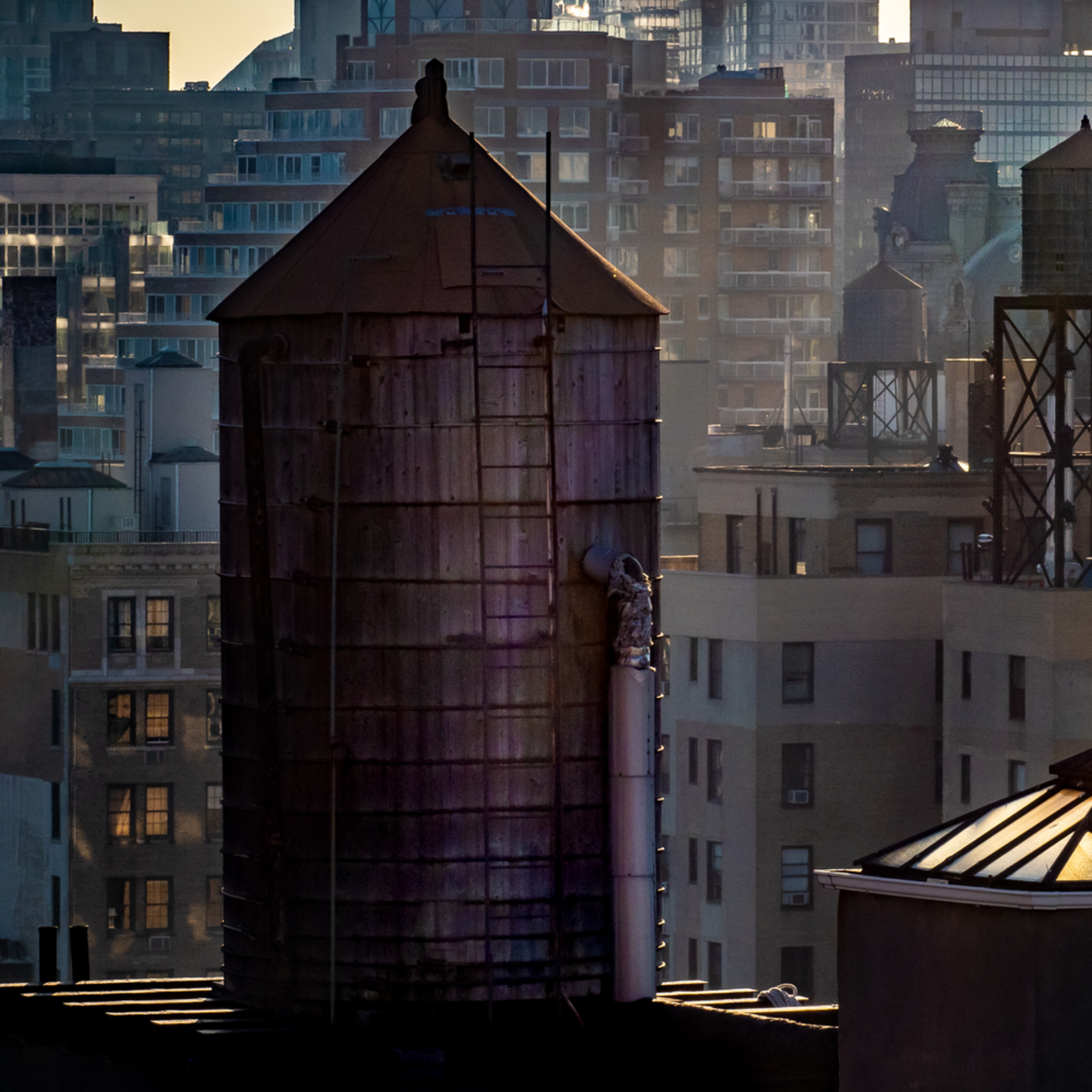 A very dark water tower at sunset nyc 2 19 5 sxsjnp