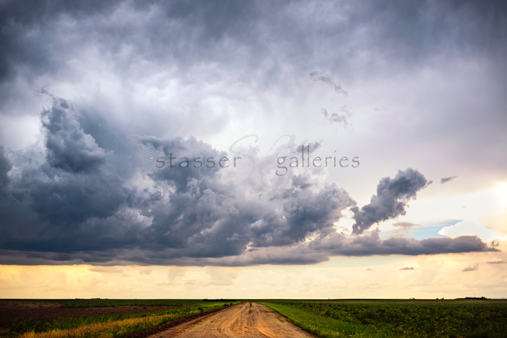 storm clouds over a traveled road