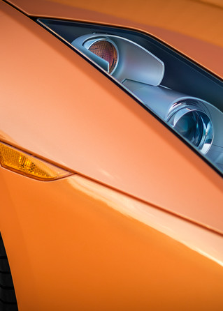 Close up photograph of Orange Lamborghini Gallardo's Headlights