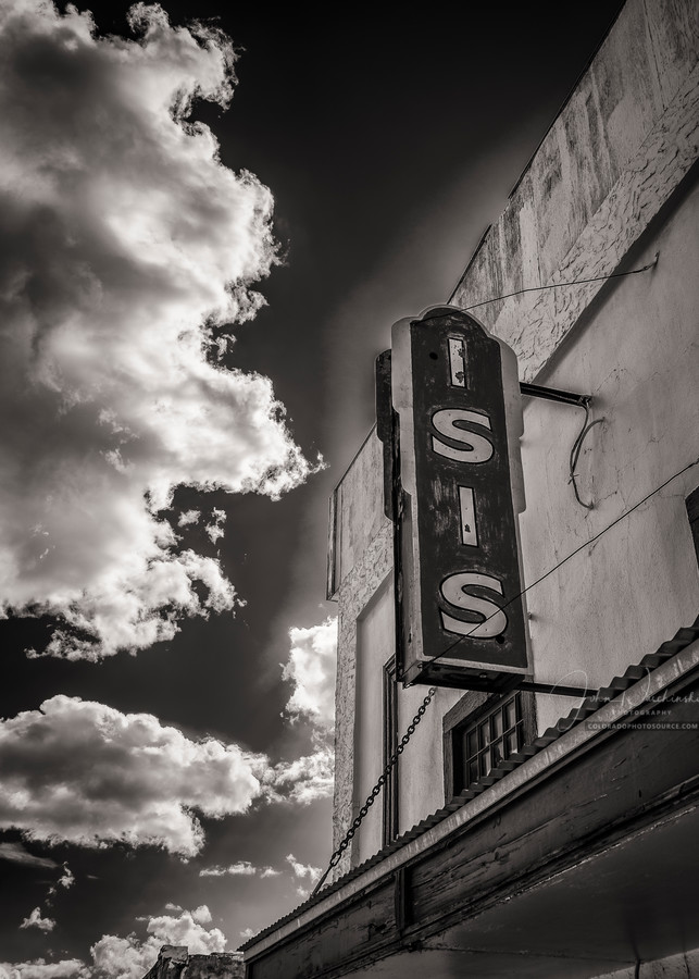 Vertical B&W Sepia Toned Photo Old Isis Movie Theater Historic Downtown Victor Colorado.