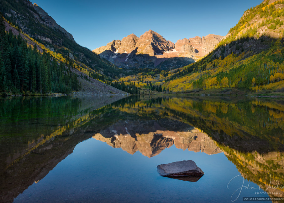 Photo of Aspen Maroon Bells in Colorado Reflecting Upon Maroon Lake