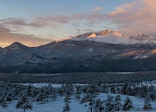Wide Panorama Photo of Snow Covered Longs Peak & Beaver Meadows at Sunrise