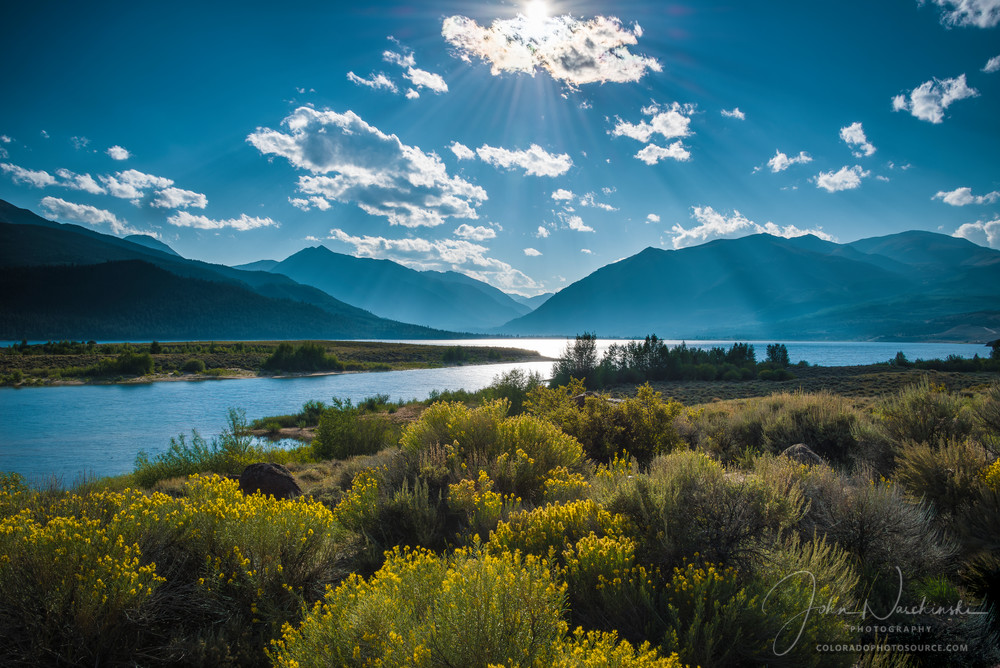 Photograph of Twin Lakes Colorado Leadville Light Rays Through Clouds Illuminating Yellow Wildflowers