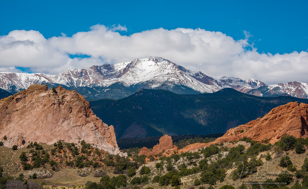 Garden of the Gods in Spring Photographed with Blue Skies, White Clouds, Pikes Peak Snow