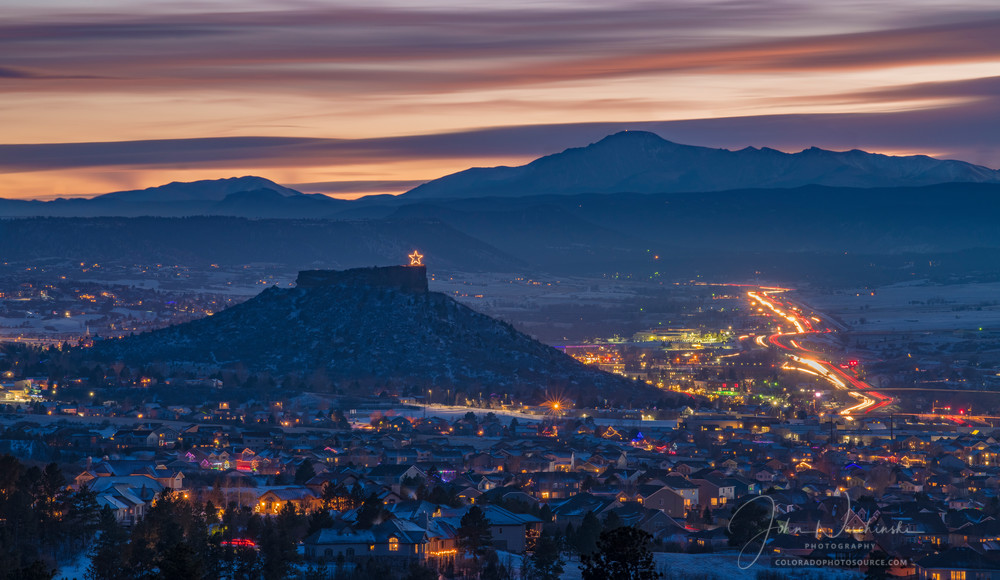 Nighttime Photograph Above Castle Rock Christmas Lights Twinkle