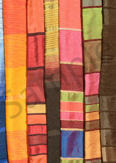Colorful Moroccan fabrics in Essaouira market