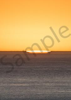 Fine art photograph, panoramic, surreal sunset with a hint of sun on horizon