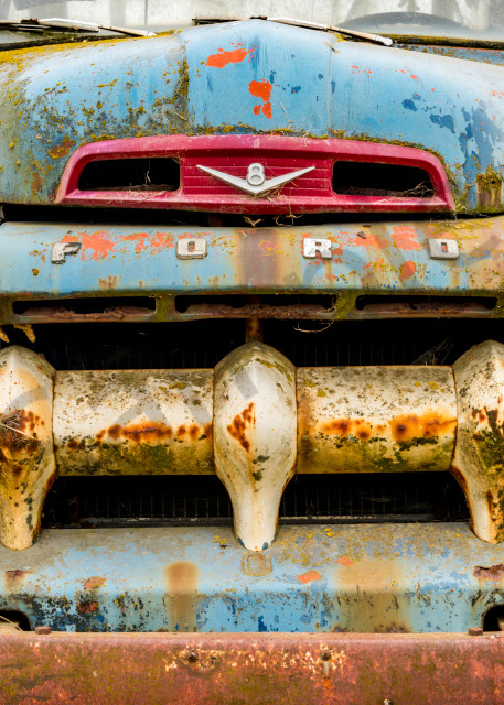 Rustic Ford truck with large grille from front in art photograph