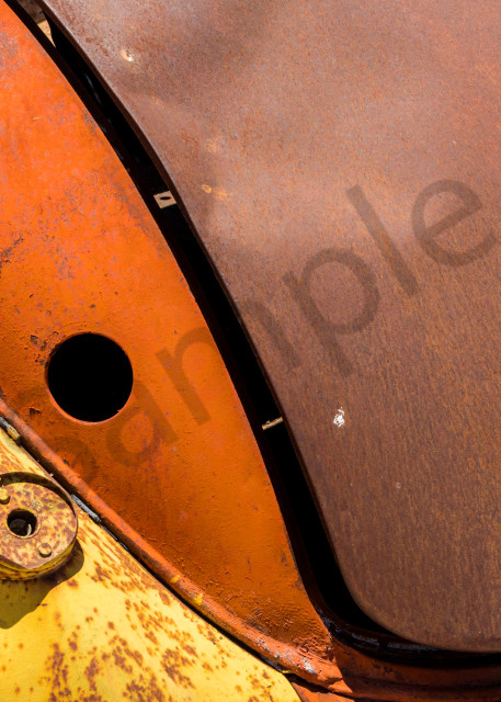 close-up of the back of an old rusting colorful Hudson car in an art photograph