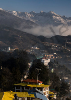 Panorama of Tawang with monks playing flutes at sunrise art photograph.