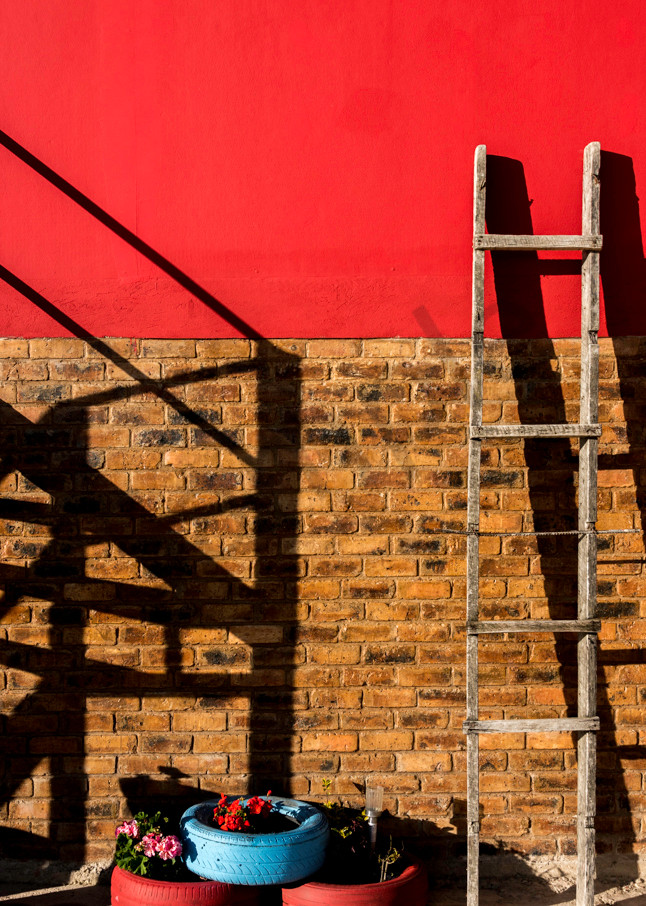 Ladder on a red wall, Lake Tota