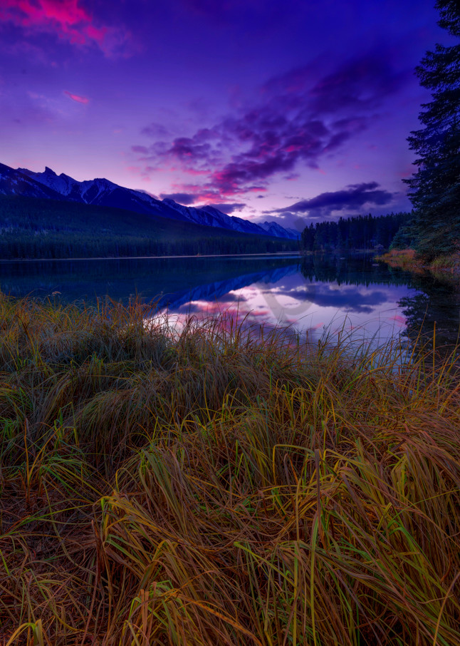 The late Fall sky shimmers with hues above the Canadian Rockies|Banff National Park|Rocky Mountains|