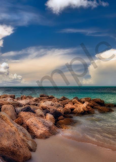 Rock jetty and cumulus clouds