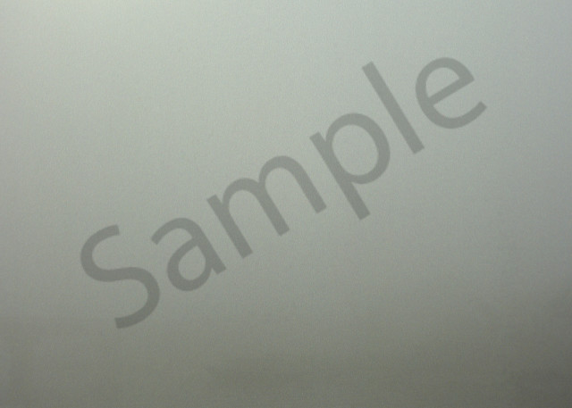 small boat on misty river with gray foggy background