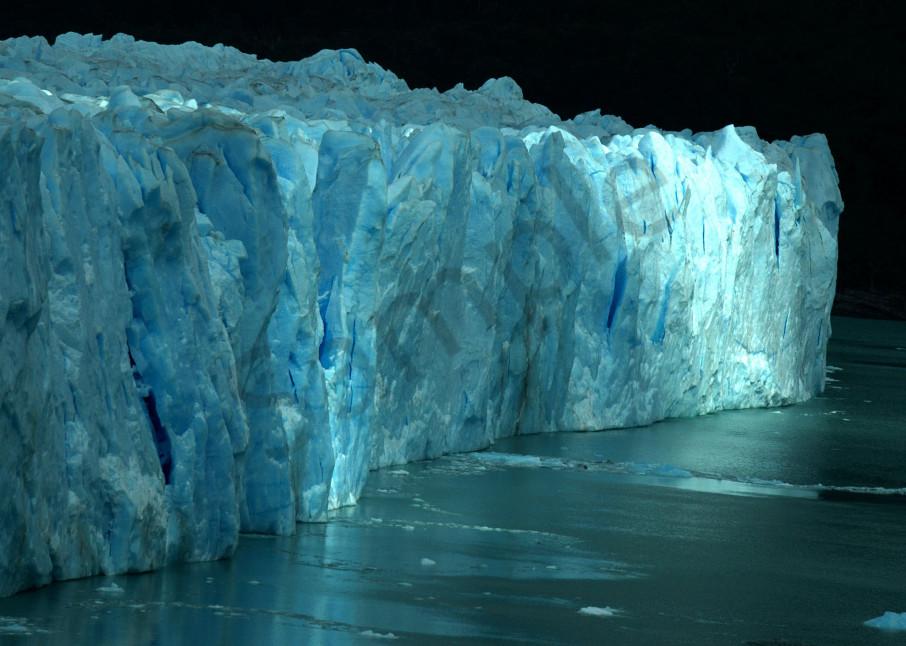 Perito Moreno Glacier lit up by single ray of sunlight