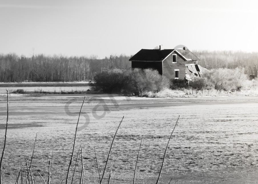 Black & white photograph of an abandoned Ontario farmhouse in a field, for sale as fine art by Sage & Balm