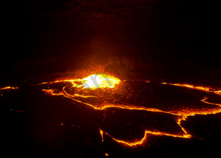 Exploding lava in a volcano crater in panorama.