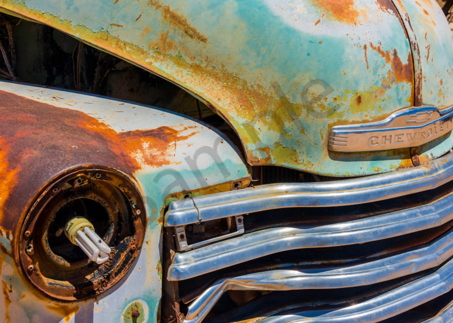 Close-up photograph art of old Chevrolet front grille with modern light bulb