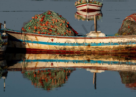 Traditional fishing boats reflection pano