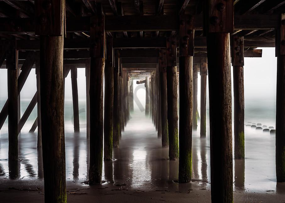 Eerie view under pier in fog