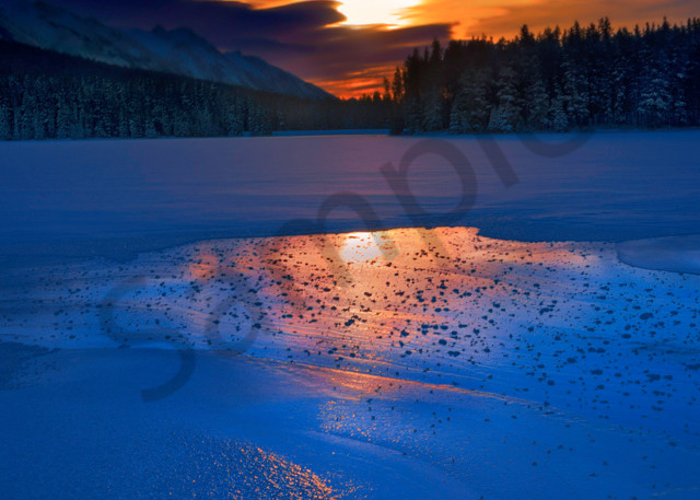 A winter sunrise from out on the ice of Two jack Lake near Banff. Banff National Park|Canadian Rockies| Rocky Mountains|