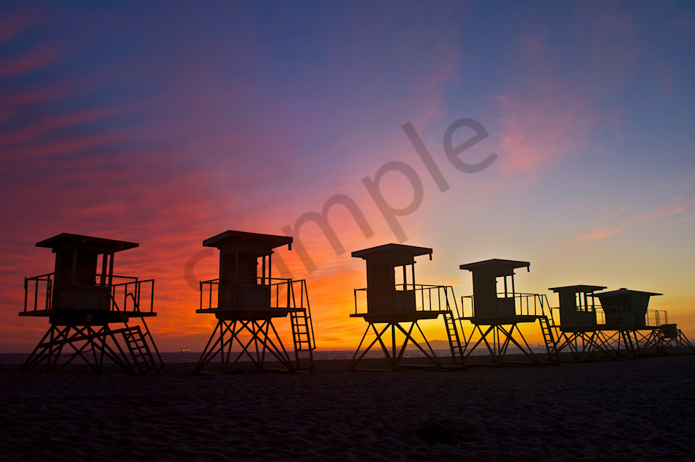 Awesome Silhouetted Lifeguard Stands at Sunset in Huntington Beach.