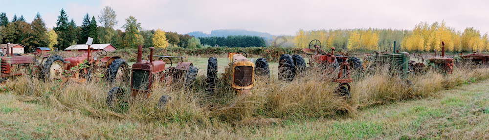 a panoramic view of tractors in fall