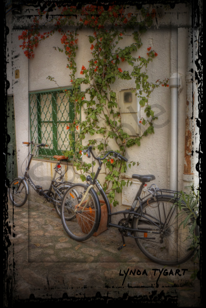 Lynda Tygart BIcycles in Spain Europe near Cafe – Fine Art Photographs Prints on Canvas, Paper, Metal & More.