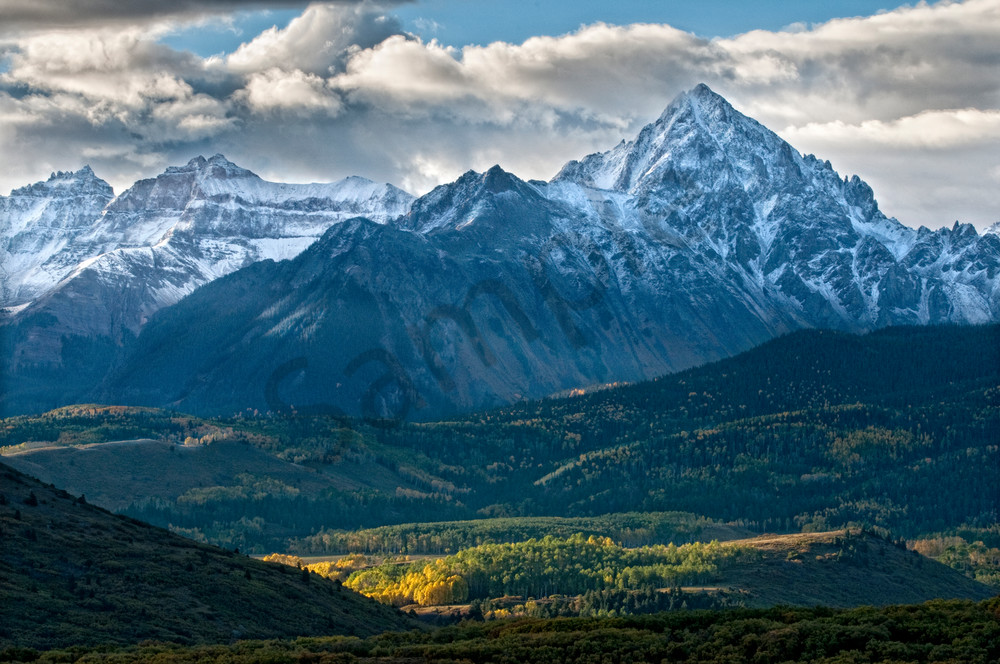 Mt Sneffels with snow and autumn treesin the valley