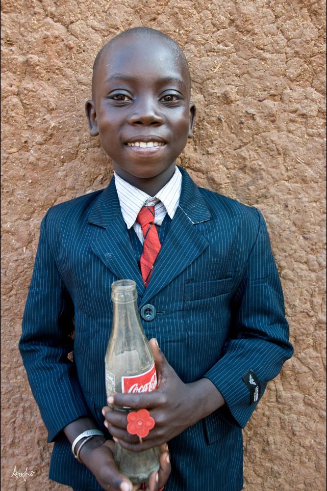 Boy in Armani suite holding Coca Cola bottle, photograph art print