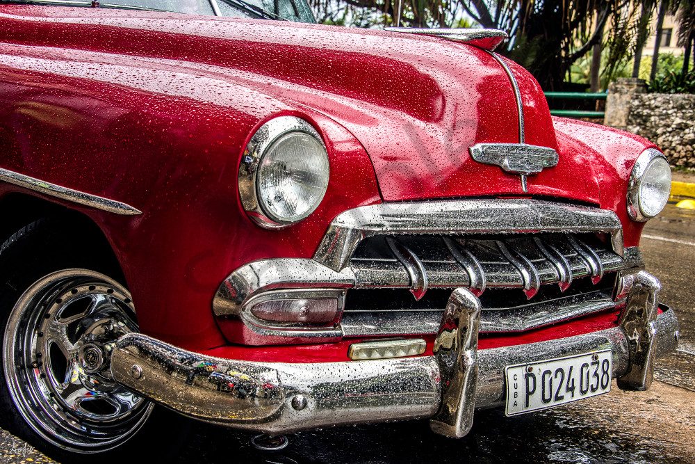 Red 1952 chevy with chrome grille and rain drops