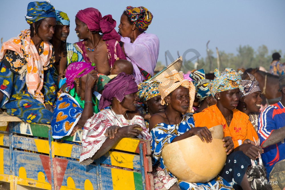 Fine art photograph of a group of Fulani woman in colorful clothes after market day
